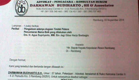 Surat Pengacara Darmawan Budiharto melaporkan Agus Supriyanto,  ke polisi atas dugaan pencemaran nama baik, Senin (3/11/2014) (Foto:Pujianto)